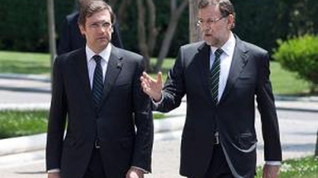 Rajoy y Coelho hacen frente común y piden a la UE que cumpla los acuerdos