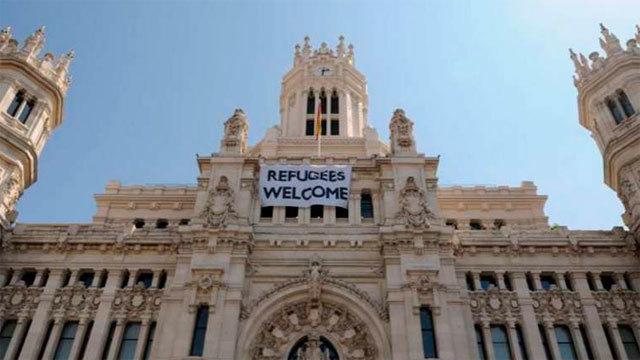 Pancarta en favor de los refugiados