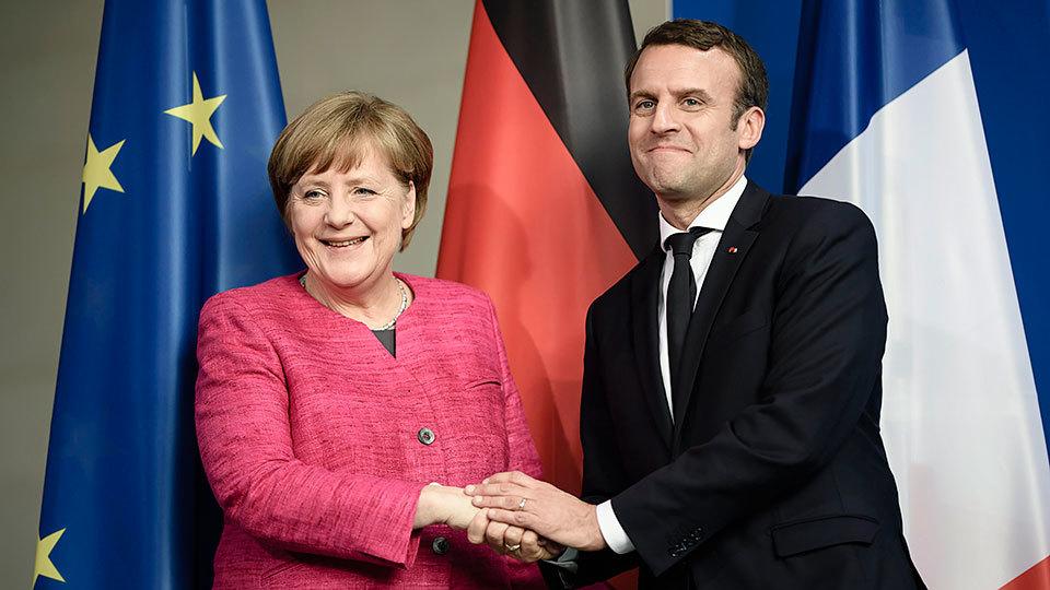 La canciller alemana Angela Merkel y el presidente francés Emmanuel Macron, tras su encuentro en la cancillería alemana en Berl