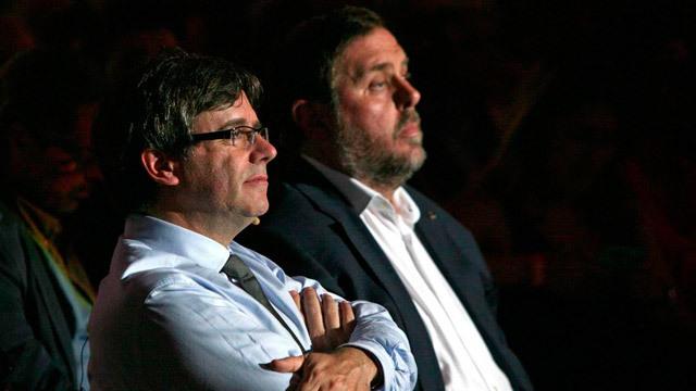El presidente de la Generalitat, Carles Puigdemont, y el vicepresidente Oriolo Junqueras