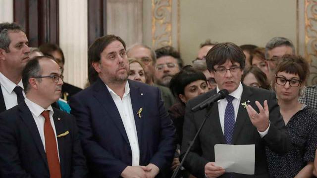 Carles Puigdemont, junto a Oriol Junqueras