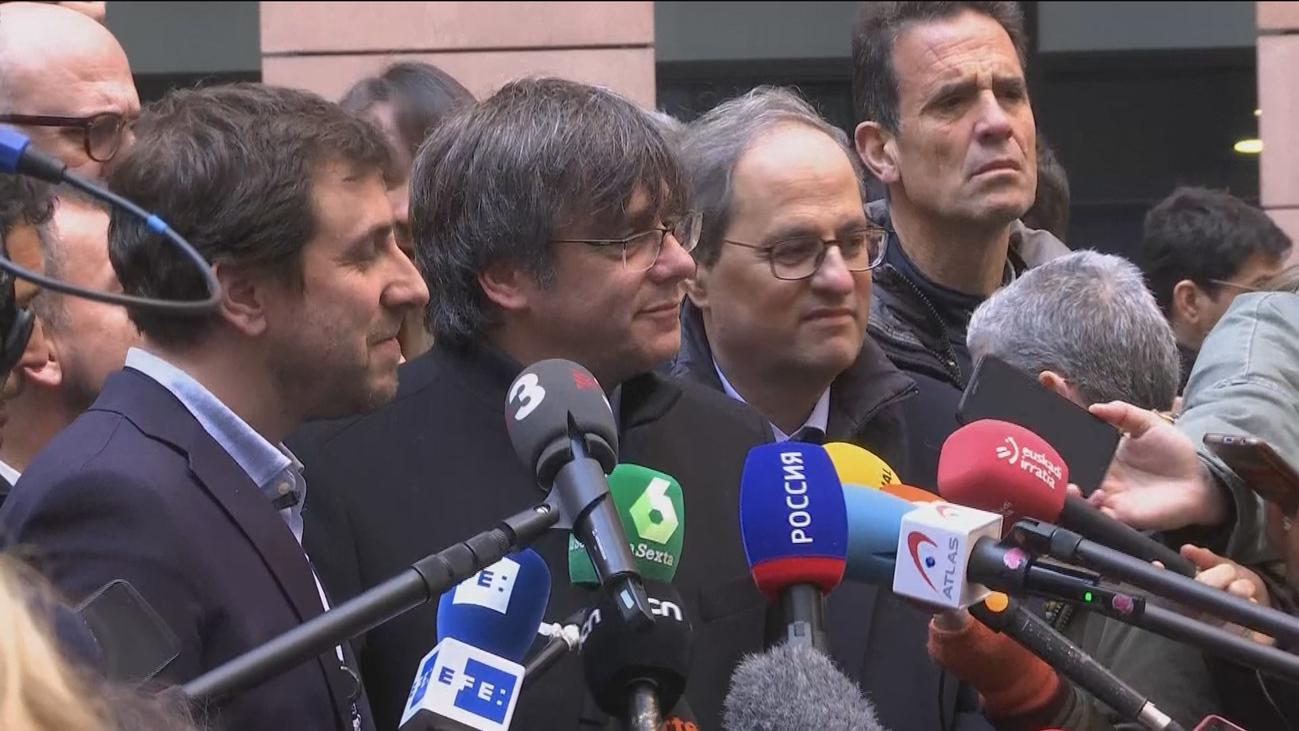 Puigdemont y Comín se estrenan como eurodiputados con el apoyo de Torra y Torrent