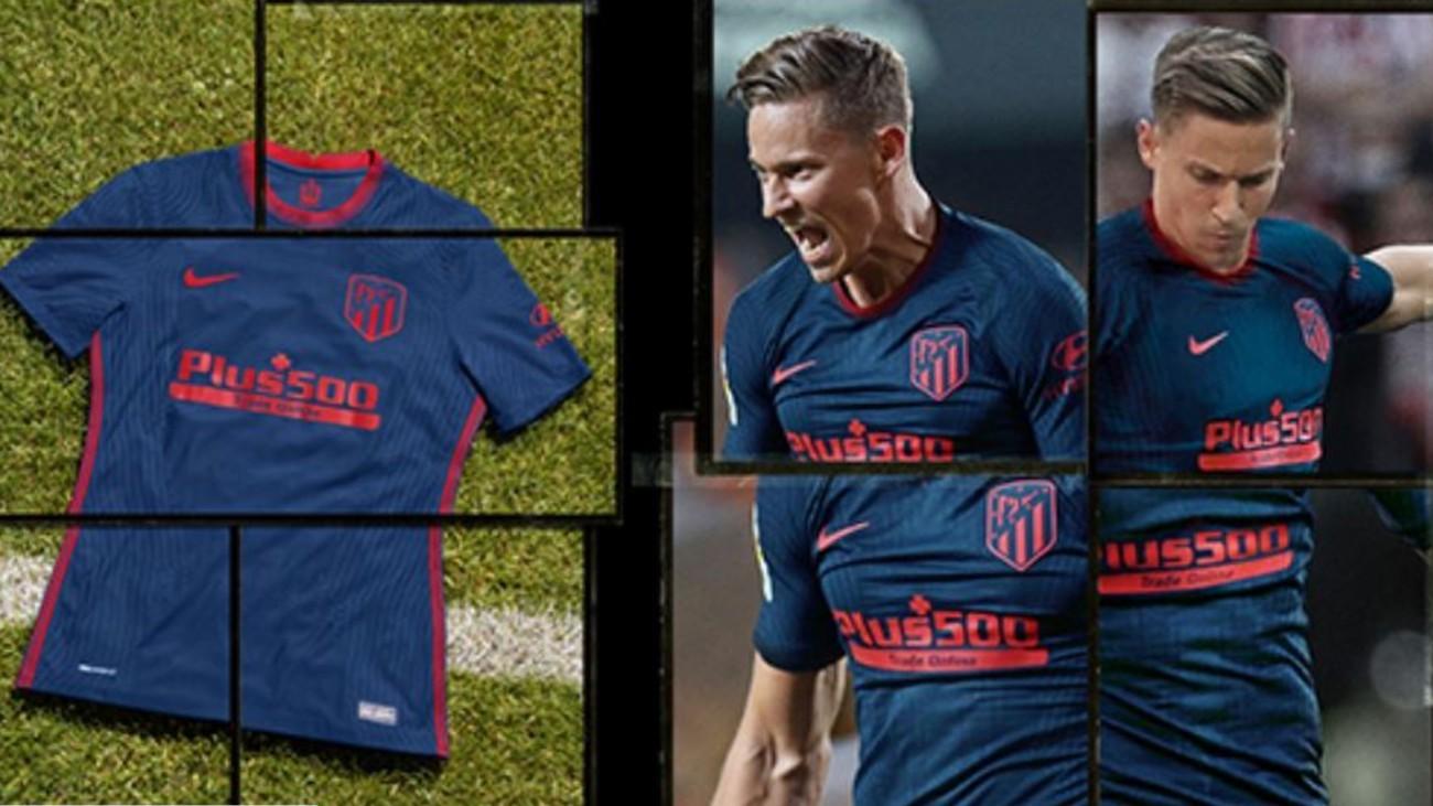 La segunda equipación del Atlético 2020-21, azul oscuro con detalles rojos