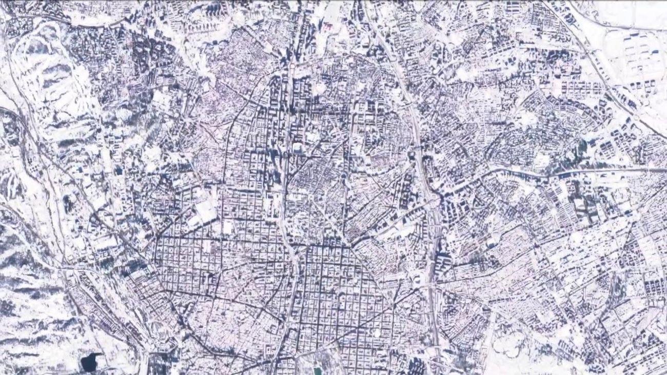 Madrid nevada y blanca desde el aire.... No, a vista de satélite