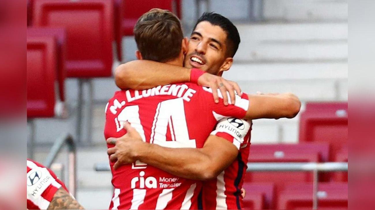 Marcos  Llorente y Luis Suárez